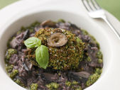Herb Crusted Portabello Mushroom with Red Wine Risotto and Pesto — Stock Photo