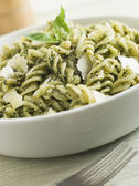 Bowl of Fusilli Pasta dressed in Pesto with Parmesan Shaves — Stock Photo