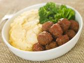 Tomato Meatballs with Parmesan Polenta and Broccoli — Stock Photo