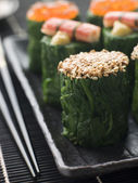 Rolled Spinach Three Ways-Snow Crab Toasted Sesame Seeds and sal — Stock Photo