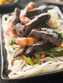 Teriyaki Beef Fillet and Tiger Prawns with Udon Noodles — Stock Photo
