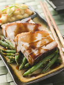 Roast Belly Pork with Fuji Apples and Peanut Beans — Stock Photo