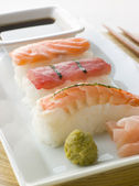 Hand Molded Seafood Sushi Wasabi Soy Sauce and Sushi ginger — Stock Photo