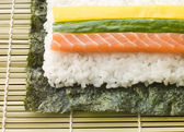Making Rolled Sushi in a Sushi Mat — Stock Photo