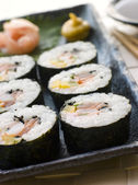 Large Spiral Rolled Sushi with Sushi Ginger Wasabi and Soy Sauce — Stock Photo