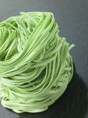 Stack of Spinach Noodles on a Black Background — Stock Photo