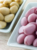 Dishes of Pickled Garlic — Stock Photo
