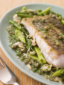 Fillet of Hake with Cockles Green Vegetables and Salsa Verde — Photo