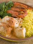 Saute of Monkfish Prawns and Rice with Pimento Cream — Stock Photo