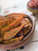 Sweet Potato Wedges with Tomato Salsa — Stock Photo