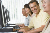 Adult students in a computer lab — Stock Photo
