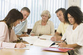 Adult students studying together — Stock Photo