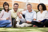 Adult students sitting on a campus lawn — Stock Photo