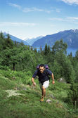 Man hiking in the great outdoors, — Stock Photo