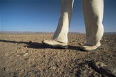 Man walking in desert, low section, , — Stock Photo