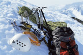 Mountain climbing equipment in snow — Stock Photo