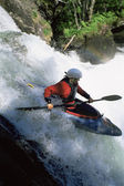 Young woman kayaking down waterfall — Foto de Stock