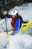 Man kayaking in rapids — Stock Photo