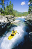 Young man kayaking in river — Stock Photo