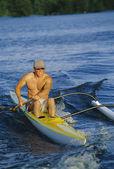Man canoeing at sunset — Stock Photo
