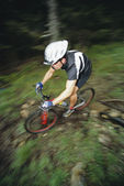 Man mountain biking — Stock Photo