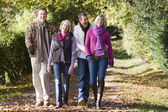 Parents and grown up children on walk — Stock Photo