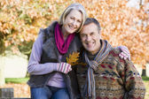 Affectionate senior couple on autumn walk — Стоковое фото
