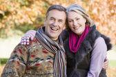 Affectionate senior couple on autumn walk — Stock Photo