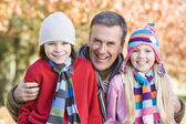 Grandfather and grandchildren on walk — Stockfoto