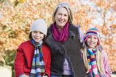 Grandmother and grandchildren on walk — Stock Photo