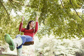 Young woman on swing — Stock Photo