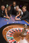 Group of friends gambling in casino — Stock Photo
