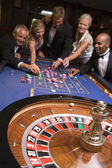 Group of friends of gambling in casino — Stock Photo