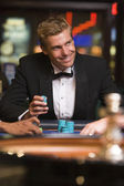 Man gambling at roulette table in casino — Stock Photo