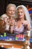 Woman celebrating bridal shower in casino — Stock Photo