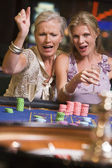 Two women gambling at roulette table — Stock Photo
