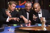 Group of men gambling at roulette table — Stock Photo