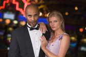 Couple standing inside casino — Stock Photo
