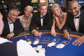 Group of friends playing blackjack in casino — Stok fotoğraf