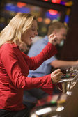 Woman winning on at slot machine — Stok fotoğraf
