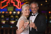 Mature couple celebrating in casino — Stock Photo