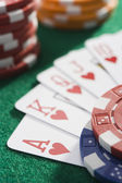 Winning hand of cards on casino table — Stock Photo