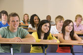 College students listening to a university lecture — Stockfoto