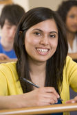 Female college student in a university lecture hall — Stock Photo