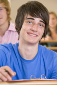 Male college student listening to a university lecture — Stock Photo