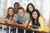 Group of college students leaning on banister — Stock Photo