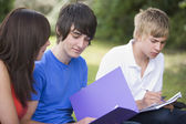 College students studying outside — Stock Photo
