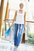 Young woman shopping in mall — Stock Photo