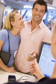Couple shopping in store — Stock Photo