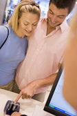 Couple making purchase in store — Stock Photo